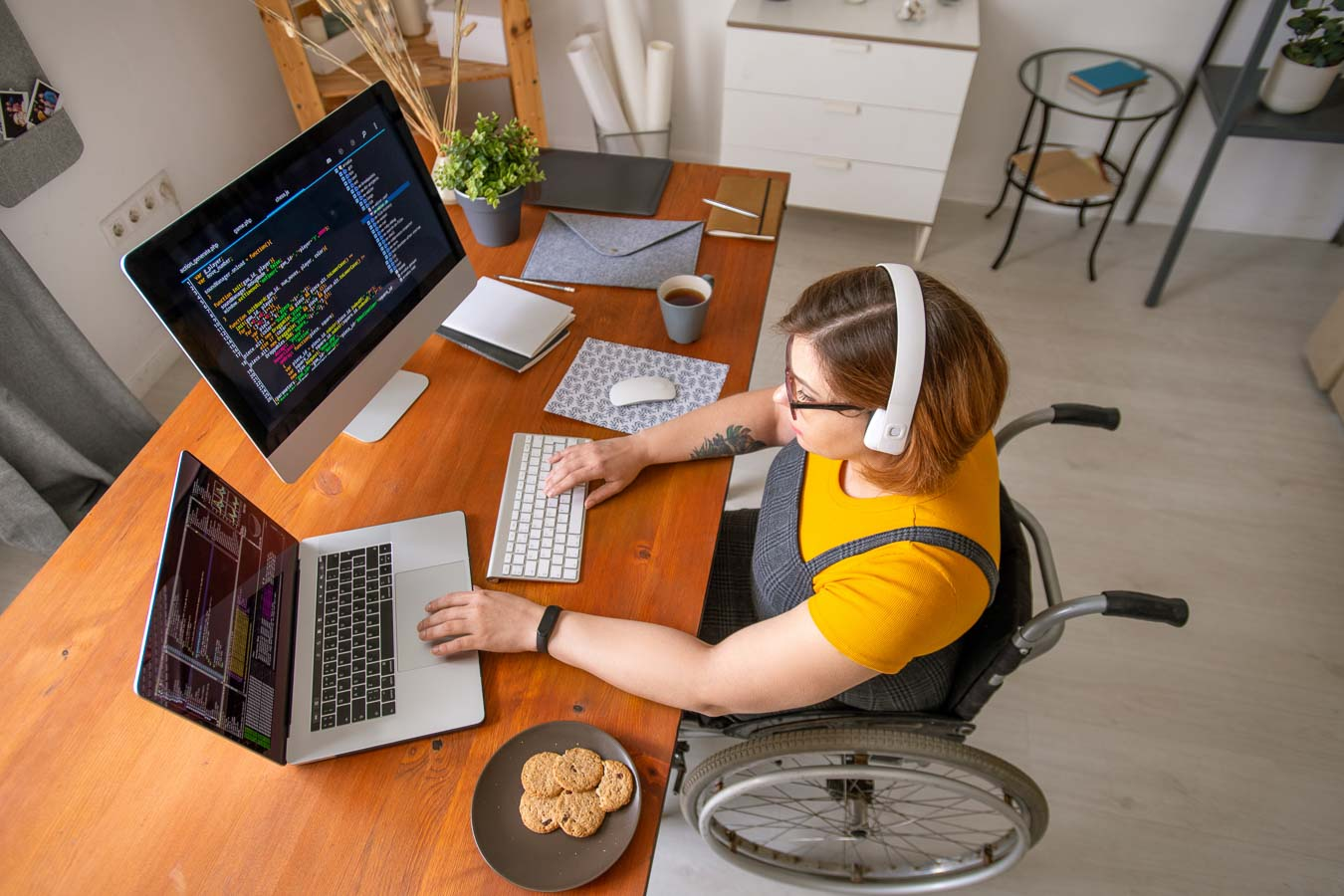 WordFest Live Media Partner - woman in wheelchair working at a laptop