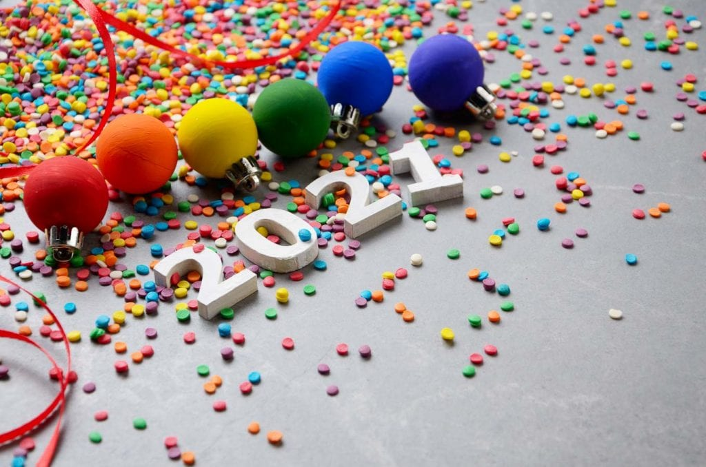 the numbers 2021 with confetti and garland